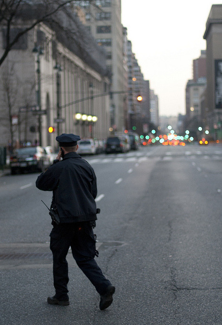 NYC Cop. On his way to catch a criminal. Or maybe to eat a bagel.