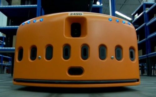 "theatlantic:  Meet The Little Orange Robots Making Amazon's Warehouses More Humane  For $775 million Amazon has acquired robot company Kiva Solutions, looking to ""improve productivity"" in those fulfillment centers we've heard such un-fun things about. Specifically, the little orange bots will bring products to workers, who as of now can walk up to 13 to 15 miles a day hand-picking and delivering items,according to a report from last September. Amazon bought the organization hoping to improve its margins — a packer working with Kiva bots can fulfill three to four times as many orders per hour, according to Kiva via The Wall Street Journal. But it looks like the tech will also reduce the exhausting walking that Amazon warehouse work now requires. […] The robot to human delivery system will replace this kind of painful-sounding work we hear Amazon's warehouse workers now experience, as described last September in a Morning Call exposé:   One former temporary warehouse employee said he worked seven months before he was terminated for not working fast enough. In his 50s, he worked 10 hours a day, four days a week as a picker, plucking items from bins and delivering them to packers who put them in boxes for shipment. He would walk 13 to 15 miles daily  Read more. [Image: kiva]   It's cuter than expected."