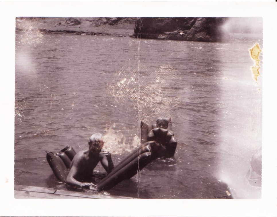 Polaroid of two kids swimming in Colorado River (1958)