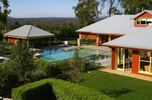 Rolling Pastures in Australia 03/19/12 Price: $4,200,000 Location: Mittagong, Australia Type of Home: Detached Home This home, roughly 70 miles from Sydney, has swaths of land for grazing cattle, alpacas or horses, while human inhabitants get to enjoy its pool and tennis court. —Vanessa Ko The hill by this rural house rises quickly, and according to properties agent Michael Maloney at Richardson & Wrench, the views get better the higher you go. 'You do get views from the house, but from the hill it's quite extraordinary,' he said.Photo: Richardson & Wrench