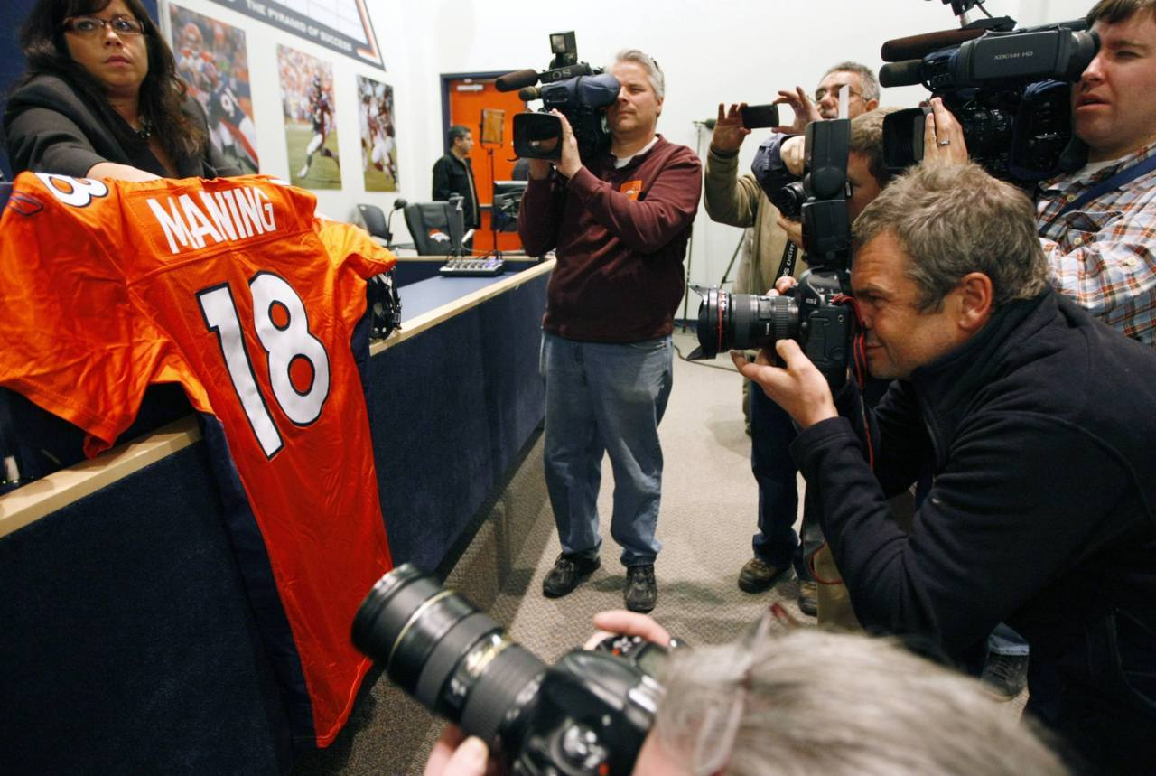 Here's hoping Peyton Manning looks good in orange. The Denver Broncos and the 11-time Pro Bowl quarterback have agreed to a five-year contract that will pay him US$96-million. REUTERS/Rick Wilking
