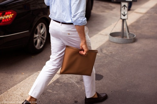 white pants and brown clutch