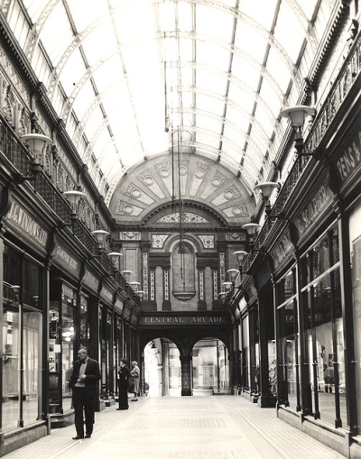modernclassics:  The Central Arcade in Newcastle upon Tyne: an elegant Edwardian triple-domed shopping arcade built in 1837 for Richard Grainger. It was originally a commercial exchange and newsroom and later an art gallery. It was rebuilt in 1906 after a fire, at which time the present Central Arcade was formed to cut through from Grey St to Market St with a link to Grainger St. Under its glass barrel-vaulted roof, the glorious tile work is a joy to behold.