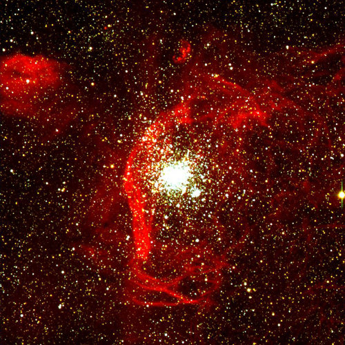 "scipsy:  Stellar Cluster NGC 1850 in the LMC  [The image] shows that there is indeed still much gas around NGC 1850. While part of this may well be the remnant of the ""parent"" gas cloud (i.e. the one from which both clusters were born), the presence of filaments and of various sharp ""shocks"", e.g. to the left and below NGC 1850, offers support to the theory of supernova-induced star birth in the younger of the two clusters. Some ""protostars"" are located near or in some of the filaments — this is interpreted as additional evidence for that theory. The nebulosity directly above the main cluster, that is shaped like a ""3"", is the well-known supernova remnant N57D which itself may also be associated with NGC 1850. Credit: ESO I figured a straight quote from the ESO site would explain a good chunk of why this image is so cool. I'd include all the technical specs, but I'm sure those who actually care will probably click through and read them. The brief overview is that this is a 300 x 300 light-year2 composite from one of the unit telescopes at the Very Large Telescope, VLT, down in Chile. Three filters, including a Hydrogen-alpha filter in the familiar red, were used to bring out as much intricate detail as possible, especially in the gas filaments. Note that this shot is from just one of the main unit telescopes at the VLT. If all four telescopes are used in interferometry mode, they have a resolving power that would be like being able to differentiate the headlights on a car at the distance of the Moon."