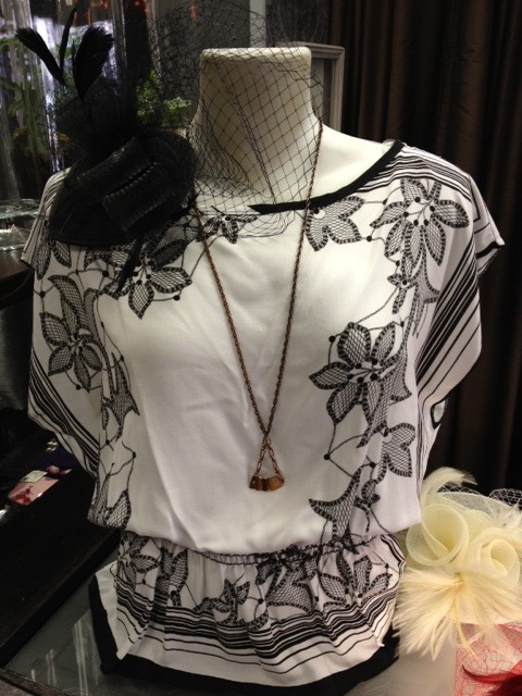 Saunter around town in this ultra feminine and flirty lightweight scarf top. With a unique embroidery pattern and a flattering waistband, this top looks great with a pair of skinny jeans or a knee length pencil skirt. Designed and made locally in CA - only $42 Available at Indie Industries in both SF locations