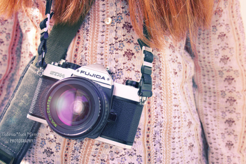 Old camera and red hair by Valeria *luce* / 2 on Flickr.