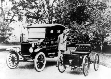 "poundoflogic:  Henry Ford posing with the tenth million automobile produced (left) and the first Ford model (right), 1924""You can have any color as long as it's black."""