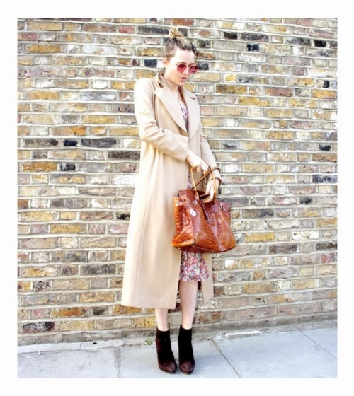 LOOK OF THE DAY Another perfect combination from Patricia, looking very much the London girl in a classic camel coat with a leather bag, adding a touch of spring with rose tinted glasses and a flash of floral. Just lovely.  - Victoria Bartley
