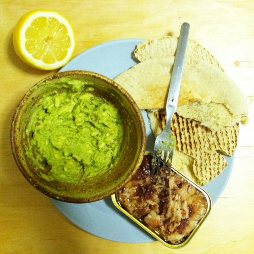 Lazy dinner consisted of mashed up avocado mixed with cumin and lemon juice, tinned sardines, and pita.