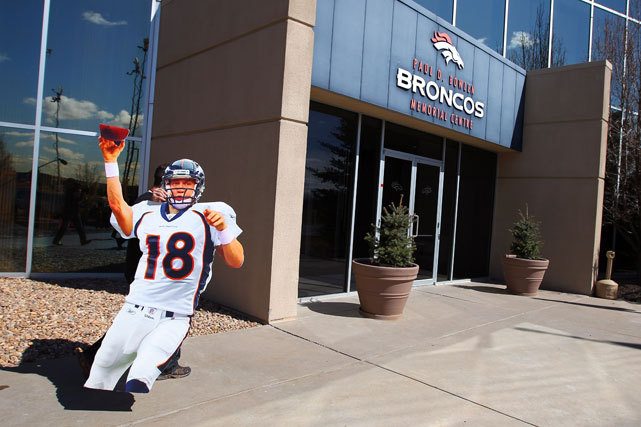 A cut-out replica of quarterback Peyton Manning in a Denver Broncos uniform is brought into the Paul D. Bowlen Memorial Broncos Centre before Manning and the Broncos hold a news conference announcing the quarterback's signing. (Doug Pensinger/Getty Images) GALLERY: Rare Photos of Peyton ManningKING: Elway isn't the only reason Manning chose DenverBURKE: Manning's mental edge gives Broncos a boost