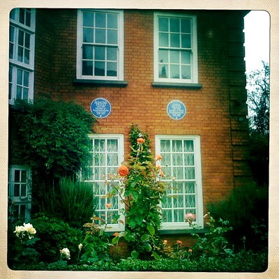 Just a wee picture from outside Freud's house in London. Nadja and I had a lovely rainy day visit poring over all of his many many antiquities and books. A very sophisticated hoarder of sorts. So many little figures and statuettes. They took up so much space on his desk that there was hardly any space left for his papers. It did remind me somewhat of being small and tucking all of my toys into the bed and then having no room left for myself and bedding down on the floor. I didn't even really love or fear most of my toys, so I still don't completely understand why I did this. Maybe just to create order. He used to greet some of them or touch different ones depending on the topics… maybe it was just how he remembered things. Instead of a mnemonic device, a tangible object representation… or a physical synesthesia linked not to his other senses but to his readings.