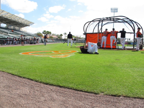 Orioles' Mark Reynolds stretches at Ed Smith Stadium before a Spring Training game against the Braves. (Steph Rogers photo)