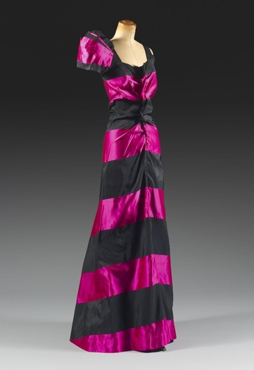 "A 1938 Elsa Schiaparelli evening gown in her signature shade: ""Shocking Pink""."