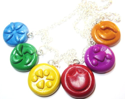 milkcannonsclaycafe:  Legend of Zelda: Ocarina of Time Sage Neckalce No matter how many Zelda games I play, I always end up going back to replay OoT :3 Now, you can own all of the sage seals and wear them proudly! For Sale on Etsy!