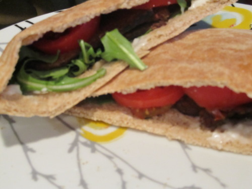 BLT with Tempeh bacon, arugula, tomato and veganise on whole wheat pita I know, I know…GASP! TEMPEH BACON?! YUCK! But this really was a great sandwich and a healthy alternative to your regular SUPER fattening BLT.  Again, I never lie and say that soy meats taste JUST like real meat…they don't. But that's ok they are still flavorful and a yummy addition to any meal. The tempeh gives the sandwich just a enough bacon flavor and the arugula is a lot more interesting than regular lettuce.  I've been using arugula in a lot of things lately….eggs, salads, pasta, sandwiches…..gives everything a more sophisticated flavor.  So let's talk about this veganaise. Now, unlike faux meat, I think that veganaise actually tastes exactly like mayonaise.  I looked at the ingredients and it's really only missing the egg other than that it's the same thing….same flavor.  I mean I guess you could tell the difference if you took a spoonful of each and compared….but who's doing that? So, for the purposes of a sandwich or wrap, it works just fine in my opinion.     Try it out! You just might like it! :)