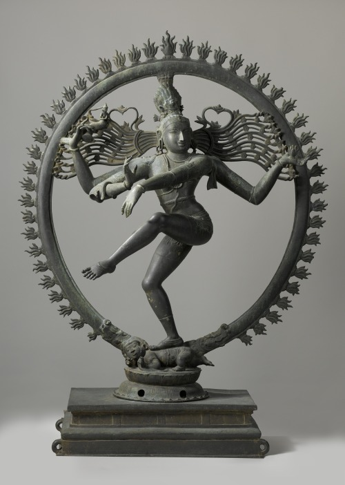 "Nataraja, Shiva as the Cosmic Dancer  ""The perfect embodiment of rhythmic movement.""  - Auguste Rodin, The Dance of Shiva - A Study on The Tiruvalangadu Nataraja at Madras Museum His dance is the dance of the cosmos, the eternal rhythm of the universe. Encircled in flames representing the cyclical nature of creation and destruction, Shiva is the center of it all. The artist ingeniously combines the two seemingly antithetical elements of Shiva's dance, the tremendous frenzied activity of the universe with his calmness, the complete tranquility of his facial expression shows supreme bliss and a wonderful poise, his raised leg giving him a beautiful sense balance and grace. Shiva himself representing your own fundamental consciousness, the center of all this activity.  The drum in his right hand, a Damaru, represents the rhythm of creation and in his left hand a flame represents destruction, balancing each other out perfectly. He points at his foot, bent slightly giving him a further sense of balance, and the little, hideous dwarf being crushed beneath. This dwarf represents ignorance, or illusion, Maya; the small and selfishly absorbed parts of yourself which blind you from perceiving the true nature of our world. That you are not separate from all the gyrations of atoms and molecules which make up the universe, that you are the great dance of Shiva. You are not aloof, you are and are made of the cosmos. When you crush the illusion of separateness, see through it, you will be released from bondage and achieve Yoga, Union with Shiva. Know Thyself. (Adapted from V.S. Ramachandran's Neurology and the Passion for Art lecture)                                                ॐ नमः शिवाय"