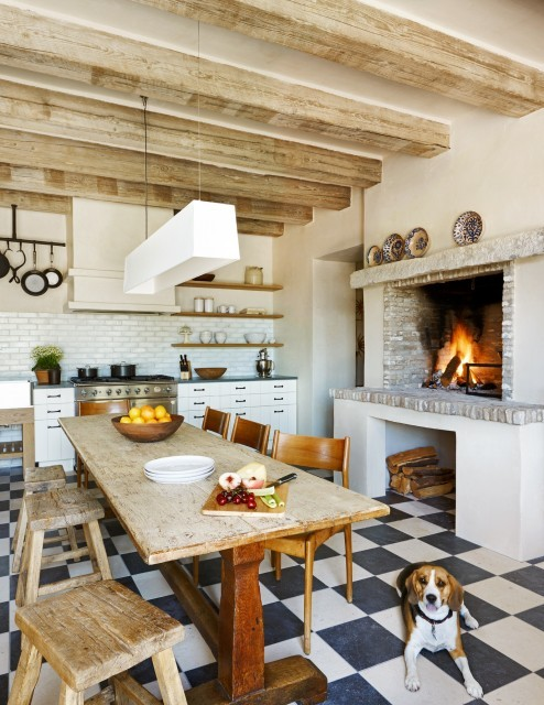 A rustic eat-in kitchen with an old-fashioned cooking firepace (via Don Ziebell)
