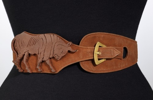 A wonderful Schiaparelli suede belt featuring a charging bull, 1938.