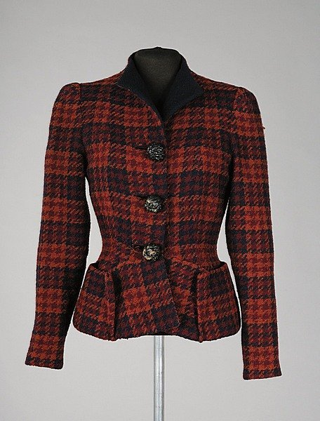 A beautifully tailored tweed jacket from Elsa Schiaparelli's Fall-Winter 1936-1937 collection. If I had this I would never take it off.