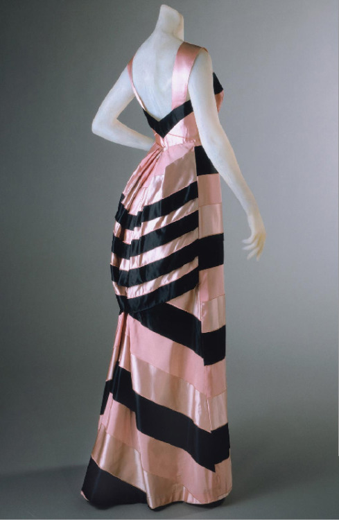 yeoldefashion:  A pink and black striped evening gown with a bustled back, Elsa Schiaparelli, Summer 1939.