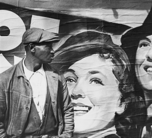 cavetocanvas:  Walker Evans, Untitled (Man and Movie Poster, New Orleans, Louisiana or Vicksburg, Mississippi), 1936