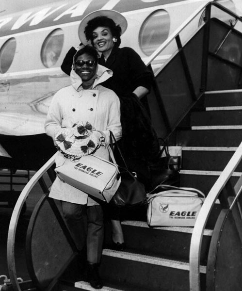 Cicely Tyson and modeling pioneer Ophelia DeVore disembarking from an airplane, probably in the early 1960s. Ms. Tyson, while doing a bit of modeling herself, trained models and actors at Ms. DeVore's famous charm school. Photo via opheliadevore.com