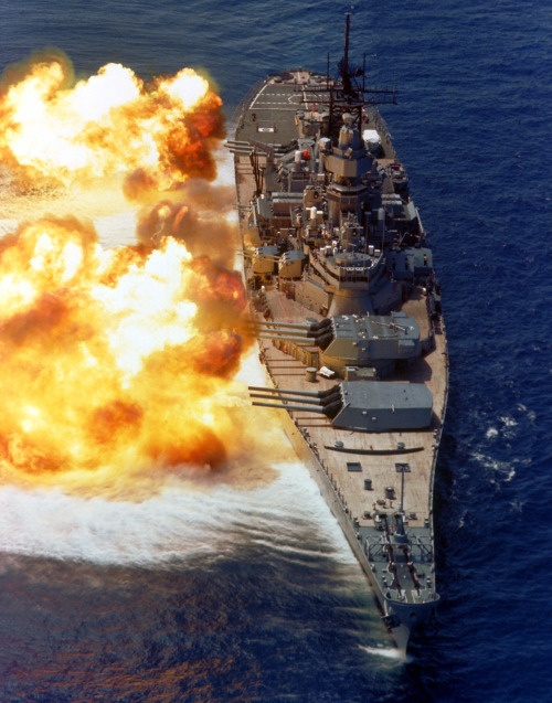 Hey Faggots, My name is USS Iowa, and I hate every single one of you. All of you are slow,unarmored, underpowered no-lifes who spend every second of their day being shadowed by aircraft. You are everything bad in the world. Honestly, have any of you ever sunk a ship? I mean, I guess it's fun to sink a world war one era battlecruiser, but you all take it to a whole new level. This is even worse than being defeated by escort carriers and destroyers.  Don't be a stranger. Just hit me with your best salvo. I'm pretty much perfect. I have 12.1 inch side belt armor, and a top speed of 31 knots. What submarine detection equipment do you have, other than primitive sonar? I also get a displacement of 45,000 tons and have banging hot 16 inch guns ( She just fired; Shit was SO cash). You are all faggots who should probably scuttle yourselves. Thanks for listening. Pic Related: It's me and my 16 inch guns firing a full broadside in a firepower demonstration.