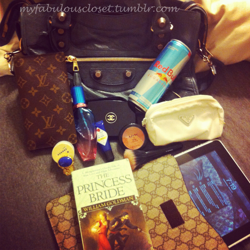 myfabulouscloset:  What's in my Purse: Balenciaga Giant City Louis Vuitton wallet Escada Island Kiss perfume Jack Black Lemon & Chamomile lip balm Korres Guava Lip Butter YSL Arty Ovale ring Chanel Moisturizing Bronzing Powder backup 12 oz. Red Bull NYX cream blush in Tea Rose Prada cosmetic bag Hello Kitty for MAC Stippling brush iPad (I want the new one so bad!) The Princess Bride (one of my favorite favorite favorite books!)
