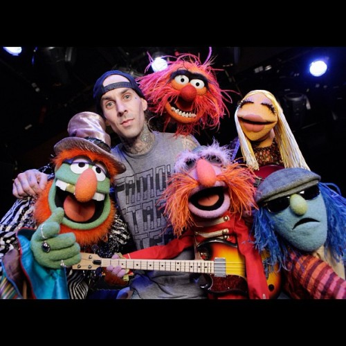 Stayin up late to watch Travis Barker drum battle Animal from The muppets.