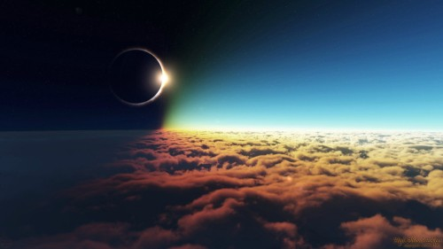 Solar Eclipse above the cloud. The colours are beautiful, and the glimpse of the sun is magical. Not my photo.