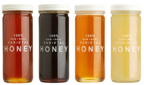 Honey packaging considertheaesthetic:  Sometimes it's surprising to see just how simple packaging can get, and still be so beautiful. In this instance, the rich golden brown shades of the honey is all Bee Raw Honey needs to sell their product.