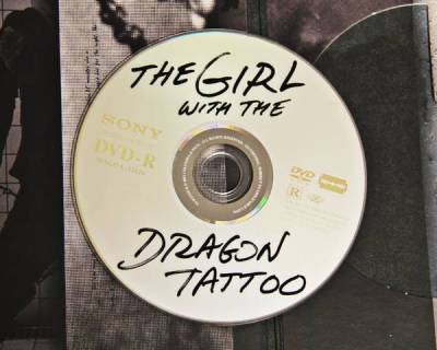 dbreunig:  The official design for The Girl with the Dragon Tattoo DVD. Do we have nostalgia for 10 years ago already? Must be a record. Excuse me while I leak an upcoming glitch artist's EP via MiniDisc. (Via Boing Boing)  Perfect.