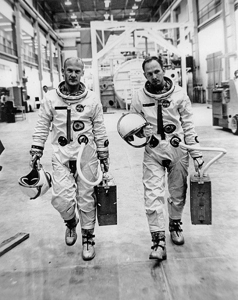 Buzz Aldrin and Ted Freeman. (via, via) This looks like it was taken in October 1964:  On Friday, October 30, Ted Freeman and Buzz Aldrin were engaged in a little public affairs activity for NASA, demonstrating their spacesuits and a mock-up of the Gemini spacecraft for a few members of the press.  However, Freeman would never fly a Gemini mission:  On October 31, 1964, Theodore Freeman was killed when a goose smashed through the cockpit canopy of his T-38 Talon jet trainer. Flying shards of Plexiglas entered the jet engine intake and caused the engine to flameout. Freeman ejected from the stricken aircraft, but was too close to the ground for his parachute to open properly.  Buzz Aldrin went on to be the second man on the Moon.