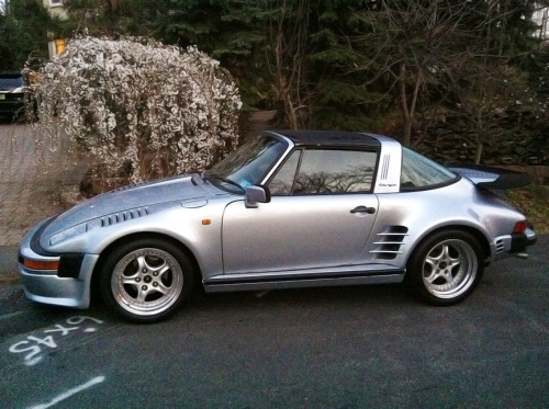 Slant Nose Targa: Option 505 Saw it just before dusk last night and immediately slammed the brakes and turned off to make a u-turn. It might be a real 911 Targa Slant Nose, but if the wheels are any indication of an aftermarket job, it might not be. If it were real, it would have 505 checked off the factory options list. Real slant nose 911s are rare, real targa slant noses are even rarer (generally less desirable though). It's a beauty, and the setting sunlight on the silver body made my heart melt. If it were a 930 Turbo slant nose, I don't think I would have left the scene, ever.