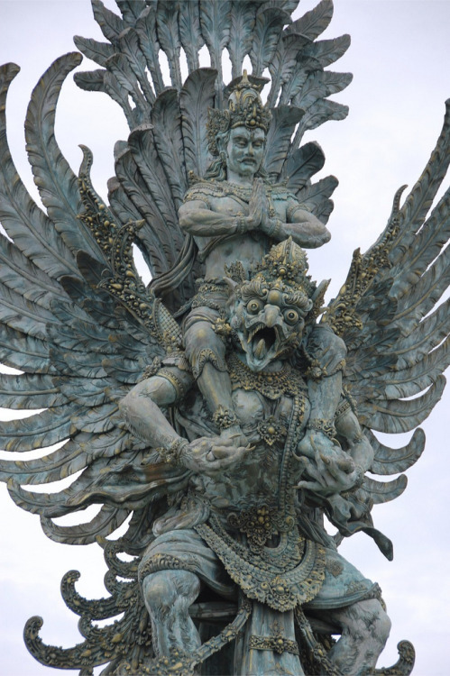chailatteplease:  A sculpture in Bali Indonesia of Vishnu riding a Garuda, a large mythical bird-like creature that appears in both Hindu and Buddhist mythology.