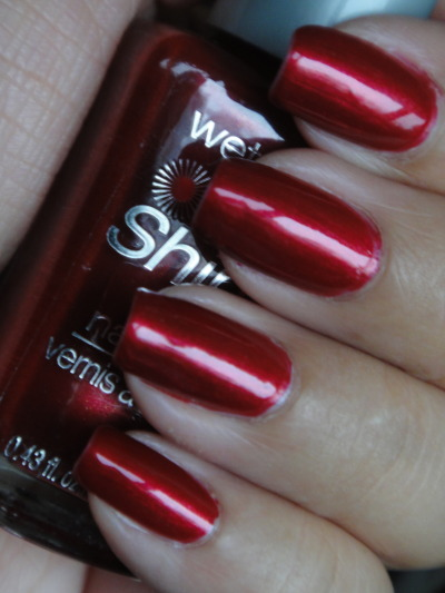 Wet n' Wild - Jezebel Jezebel is a shimmery slightly darkened red. I really liked the color in the bottle but I did not feel th same once I applied it. It was a cheap buy though at Rite Aid. Picked this one up during one of their buy 1 get the second 1/2 off, and they are only .99 cents each.