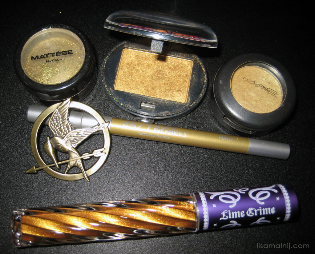 Mockingjay pin, Matesse, Urban Decay and Lime Crime Carousel Gloss in Golden Ticket.I was channeling some golden eyeliner from Cinna.Follow my Hunger Games Blog post for more photos in this set.