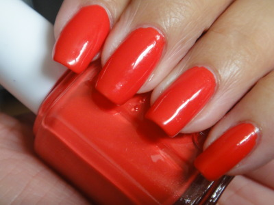 Essie - Tangerine A bright orange cream, you are sure to catch everyone's eyes when wearing this color. Tangerine is an orage with a light touch or red. Two coats to achive opaque, smooth polish.