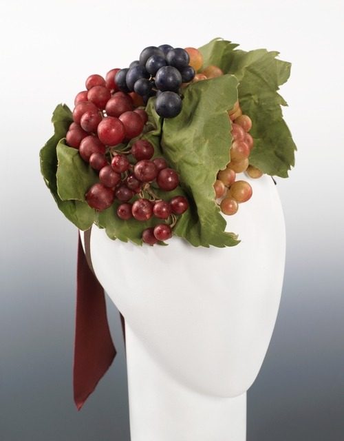 A grape covered Schiaparelli cocktail hat, Fall-Winter 1939.
