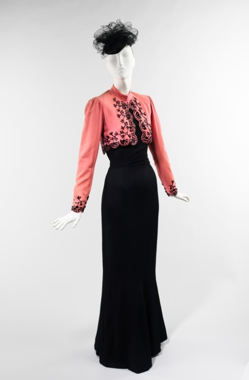 A 1940 Schiaparelli ensemble in black and Shocking Pink.