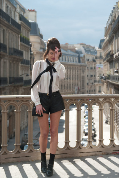 Street Chic_ Fashion Is A Playground blogger in a white sheer blouse, black shorts (both from ZARA), and black ASOS shoes. This monochromatic outfit and outfits like these are all the rage for spring 2012. I'm totes gonna go get me one this weekend!