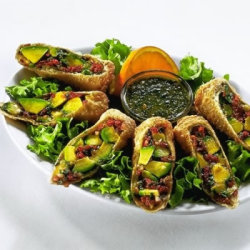 "Eggrolls1 large avocado2 Tbsp chopped sun-dried tomatoes (bottled in oil)1 Tbsp minced red onion1/2 tsp chopped fresh cilantroPinch of salt3 eggroll wrappers1 egg, beatenVegetable oil for fryingDipping Sauce3/4 cup chopped cashews2/3 cup chopped fresh cilantro2 cloves garlic, quartered2 green onion, chopped1 Tbsp sugar1 tsp ground black pepper1 tsp cumin4 tsp white vinegar1 tsp balsamic vinegar1/2 tsp tamarind pulp (I just used jam - sounds weird but it tasted fine. It is only 1/2 tsp anyway)1/2 cup honeyPinch ground saffron (I didn't have any saffron so I didn't include it.)1/4 cup olive oil1. After you peel the avocado and remove the pit, dice it into bite-sized pieces.2. In a small bowl, gently combine the avocado with the tomatoes, red onion, 1/2 tsp cilantro, and a pinch of salt. Be careful not to smash the avocado.3. Prepare the eggrolls by spooning 1/3 of the filling into an eggroll wrapper. With the wrapper positioned so that one corner is pointed toward you, place the filling about 1 inch from the bottom corner and 1 inch from each side. Roll the bottom corner up over the filling, then roll the filling up to about the middle of the wrapper. Brush the remaining corners and edges of the wrapper with the beaten egg. Fold the left and right corners over the filling and ""glue"" the corners to the wrapper. Finish by rolling the wrapper and filling up over the top corner. Press on the wrapper to ensure it is sealed. Repeal these steps with the remaining two eggrolls and keep them covered in the refrigerator while you make the dipping sauce.4. Prepare the sauce by combing the cashews, cilantro, garlic, green onions, sugar, black pepper, and cumin in a food processor or blender. Blend with short bursts until the mixture is well blended, and the cashews and garlic have been chopped into pieces about half the size of a grain of rice.5. Combine the vinegars, honey, tamarind, and saffron in a small bowl. Heat the mixture for about 1 minute in a microwave, then stir until the tamarind pulp dissolves completely.6. Pour the tamarind mixture into the blender or food processor with the cashew mixture and mix with short bursts until well combined (about 20 seconds).7. Pour the blended sauce into a small bowl. Add the oil and stir by hand. Cover and refrigerate the sauce for at least 30 minutes before serving.8. Heat oil in a deep fryer or a deep pan over medium heat.9. When the oil is hot, dry the eggrolls for 3 to 4 minutes or until golden brown. Drain on paper towels.10. Serve with dipping sauce and enjoy!"