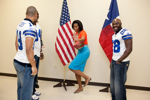 First Lady Michelle Obama does the Heisman! Coolest First Lady ever!  First Lady Michelle Obama strikes the Heisman pose while greeting Dallas Cowboys football players. (Official White House Photo by Chuck Kennedy)