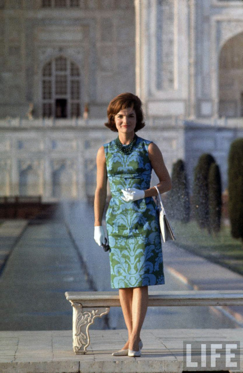The regal and elegant First Lady Jacqueline Kennedy poses on the grounds of the Taj Mahal during her tour of India ~ March 15th, 1962.