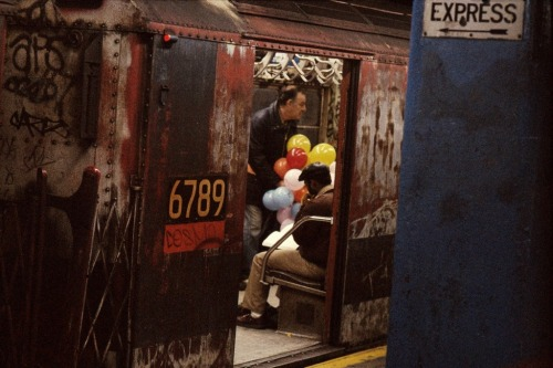 Balloons in the subway, New York, 1984 by Frank Horvat