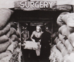 tigertrapper:  Doctors performing surgery in an underground operating room in the south Pacific, WWII.