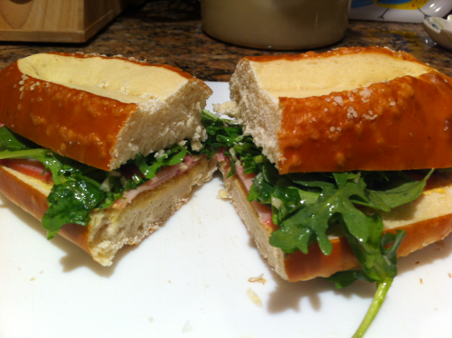 Rosemary ham, Dijon mustard, and arugula dressed with olive oil, lemon juice and garlic on a pretzel bun.