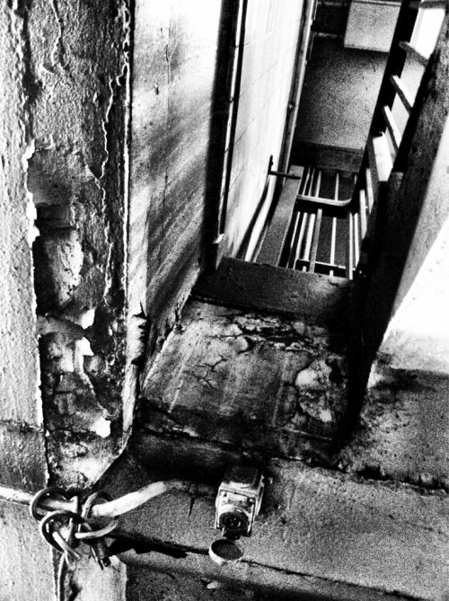 Subway Series 10 - Stairwell - NY, NY  iPhone 4, Camera+ The crumbling interior of the old subway tunnels has it's own beauty. When taking photos in a location I try to look in all directions. Sometimes right above us or below us is an image worth capturing. I loved the crumbled ceiling juxtaposed with the smooth walls and stairwell from the floor above.