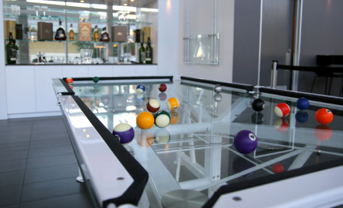 needwantcom:  G-1 Glass Pool Table  If you're going to have a games room then a pool table is a must have. A good pool table should be a thing of class and beauty, something that will make all your friends marvel and this pool table is exactly that. The G-1 Glass Pool Table is, as the name suggests, made out of glass, you may wonder how the balls could possibly roll on glass and the answer is simply that the glass has been toughened and topped off with a patented vitrik playing surface. That surface replicated the rolling resistance of an average speed cloth and is hard wearing whilst still allowing speed to be applied and retaining consistent roll characteristics over it's lifetime. Now who fancies a scotch?