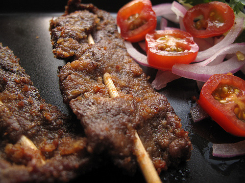 dynamicafrica:  A popular evening snack in Nigeria, the art of skewering chicken, beef or fish marinaded with a dry spice mix containing groundnuts, cayenne pepper, ginger, paprika or onion powder was made popular by the Hausa people from whom the delicacy originates. Driving through Lagos in the latter hours of the day, the roadsides are lit up with the barbecue flames of vendors selling this delicious meat snack that very few can resist - myself included. Photo credit: Pius Utomi Ekpei/AFP/Getty Images & The Kitchen Butterfly  Kebabs are also super popular in Ghana. So much flavor and goodness!